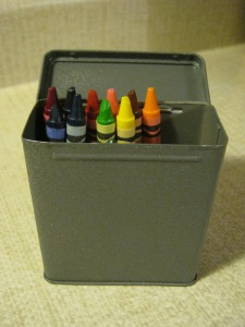 A spray-painted Band-Aids box used for crayons