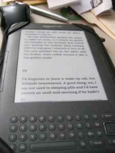 """My e-reader with a """"Vicky Bliss"""" mystery loaded. (c) 2015, Robert C Trube"""