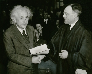 """Albert Einstein citizenship NYWTS"" by New York World-Telegram and the Sun staff photographer: Al Aumuller - Library of Congress Prints and Photographs Division. New York World-Telegram and the Sun Newspaper Photograph Collection. http://hdl.loc.gov/loc.pnp/ppmsca.05649. Licensed under Public Domain via Wikimedia Commons."